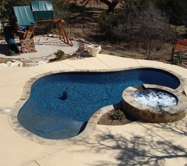 swimming pool surrounded by cement path