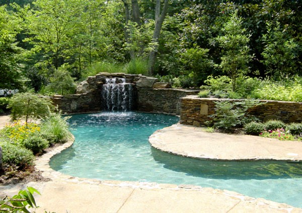 elaborate pool with a waterfall