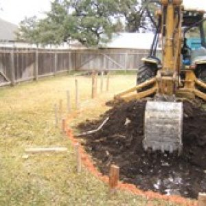 excavator in a backyard