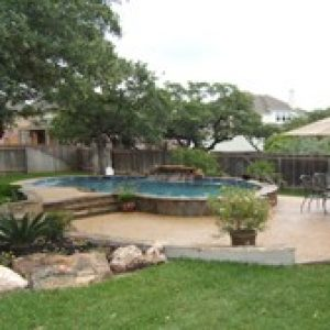 backyard with an above ground stone pool