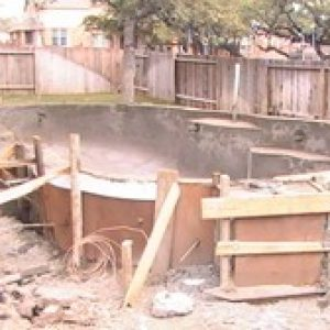 messy above ground pool construction site
