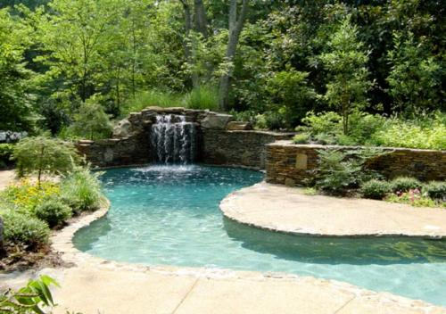 swimming pool with a small waterfall